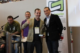 """Goldy G accepting the award for Disky when it won """"Best Mobile Project"""""""